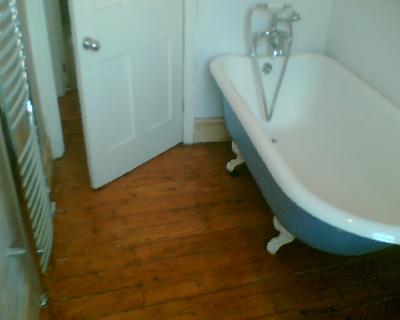 Sanded and colour varnished bathroom. Floor sanding services