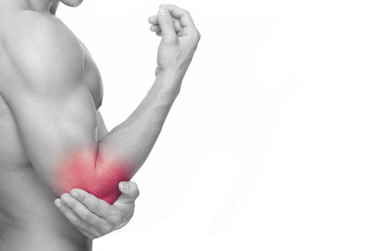 Man holding elbow with area pain found to tennis