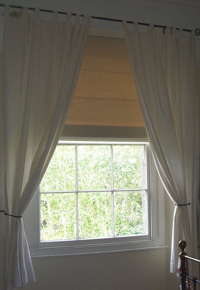 Interlined blind softened with curtains