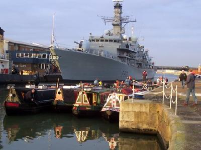 Departing Royal Docks, with Warship St Albans at the end of the Boat Show-Jan 07