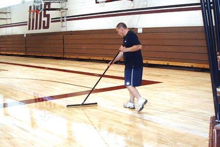 School floor sealing in progress.