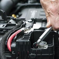 Engineer Repairing Car in Fulham