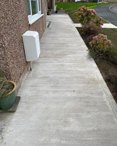 Disability Access Work completed for local authority residents. Concreted pathway and ramp.