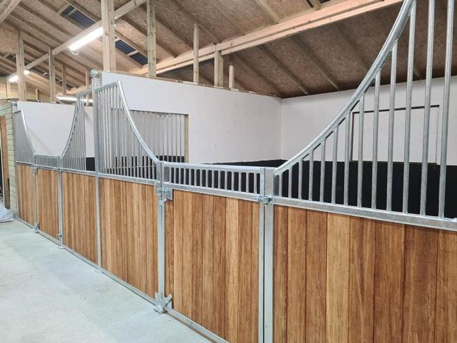 American Barn Stables Stable fronts with fitted hay bars and hay doors for easy feeding.