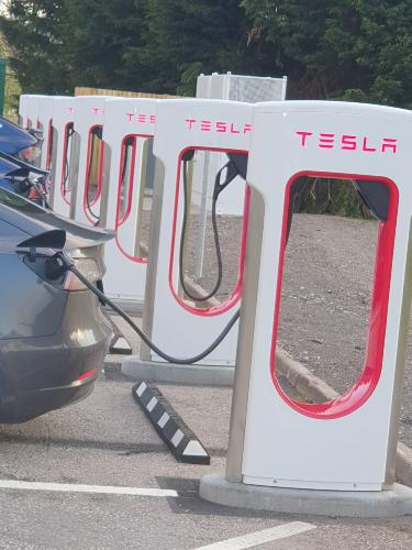 Charge your Tesla vehicle here NOW!! Tesla charging spaces now available!