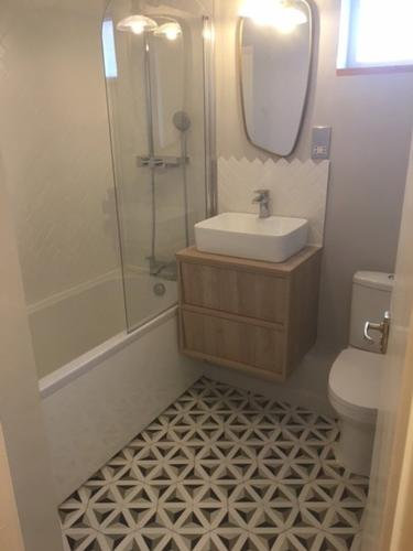 Contemporary bathroom with Feature Tiles Contemporary family bathroom with feature floor tiles