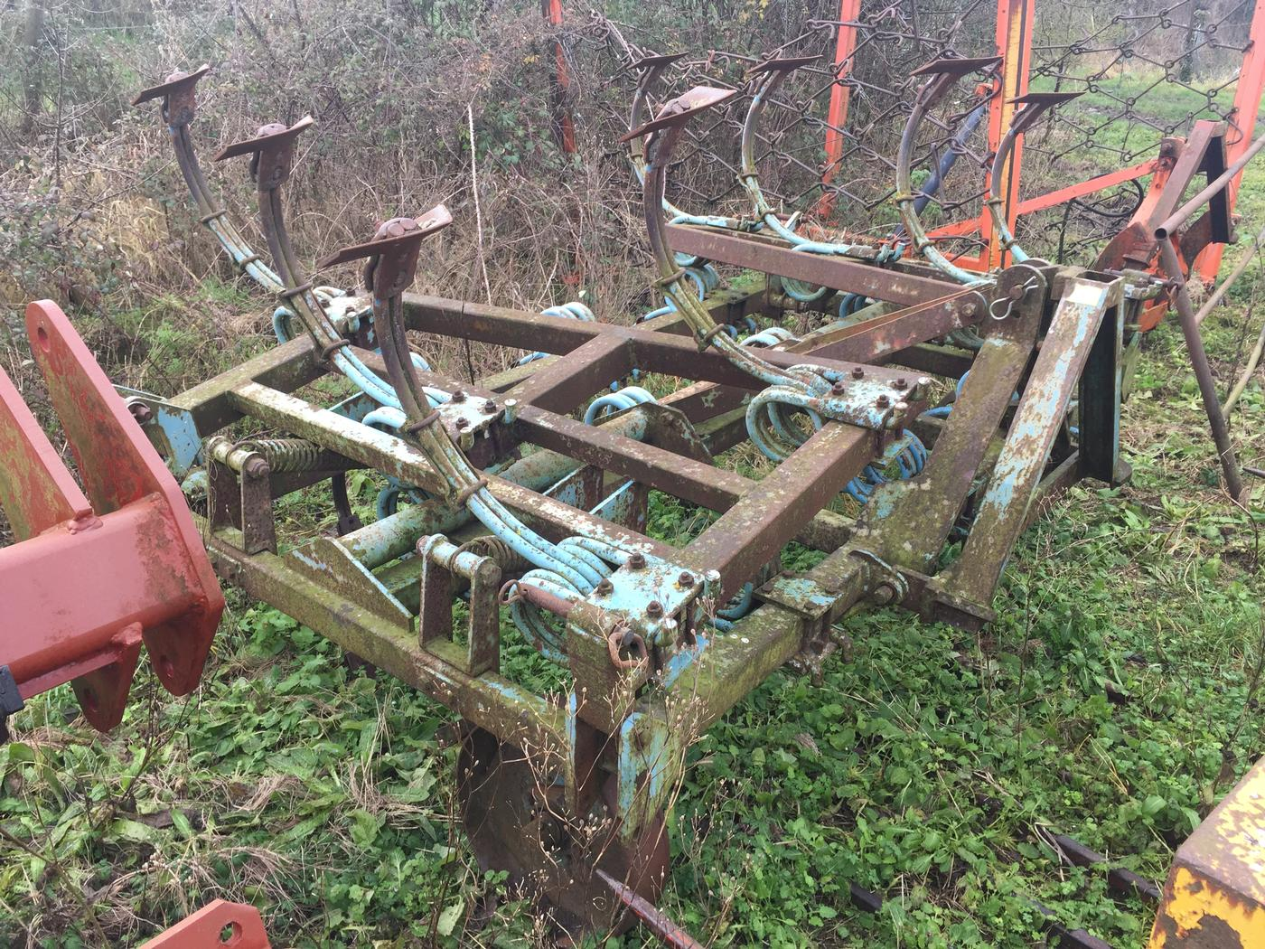 Parmiter 12ft Heavy spring tine cultivator- -twin round looped spring legs- with spring assisted fold up wings- Steel depth wheels A frame incorporated in the headstock