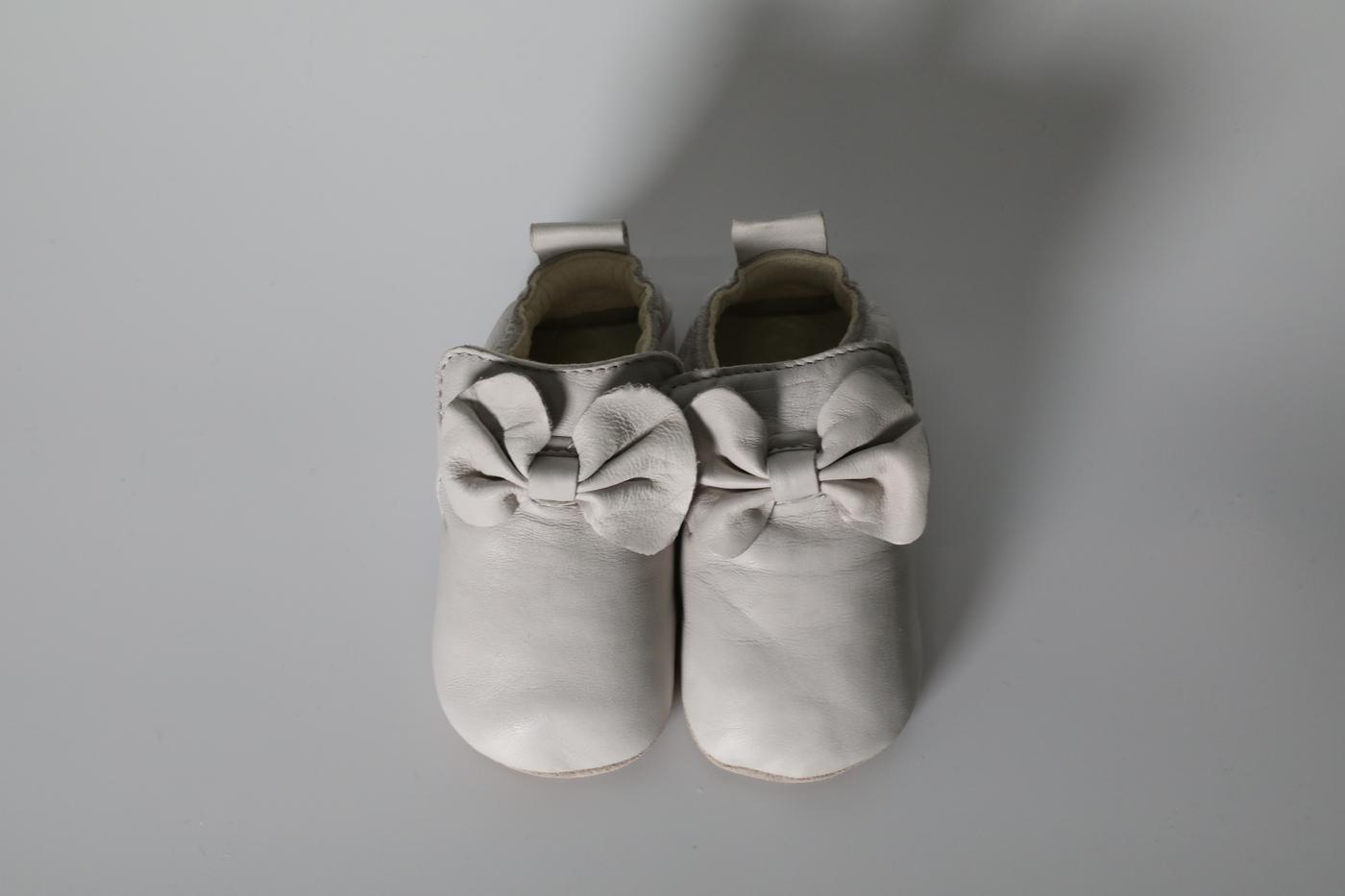 Comfy cream pram shoes