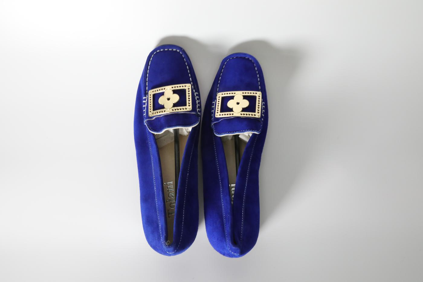 Blue loafer with gold clover styled buckle