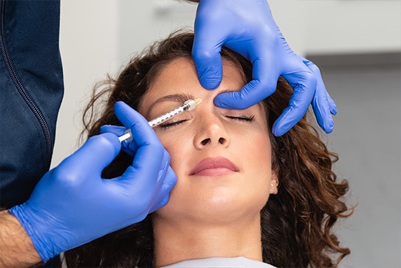 Facial Aesthetics Anti-wrinkle treatment involves injecting Botulinum Toxin, also known as Botox, or collagen material into the subcutaneous dermal layers to result in smoother, firmer, younger-looking skin.