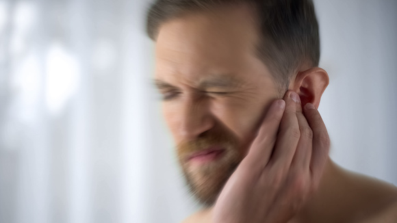 Tinnitus Tinnitus refers to hearing ringing or buzzing noises in the ears or the head.