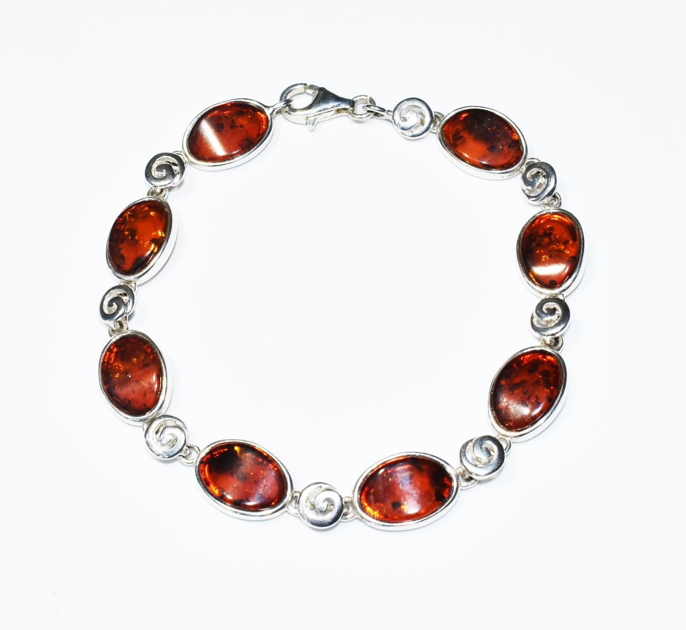 Perfect oval Baltic amber and silver bracelet.