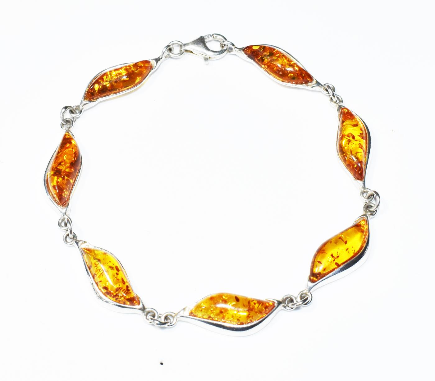 Baltic amber in cognac colour and silver bracelet in Art Deco style.