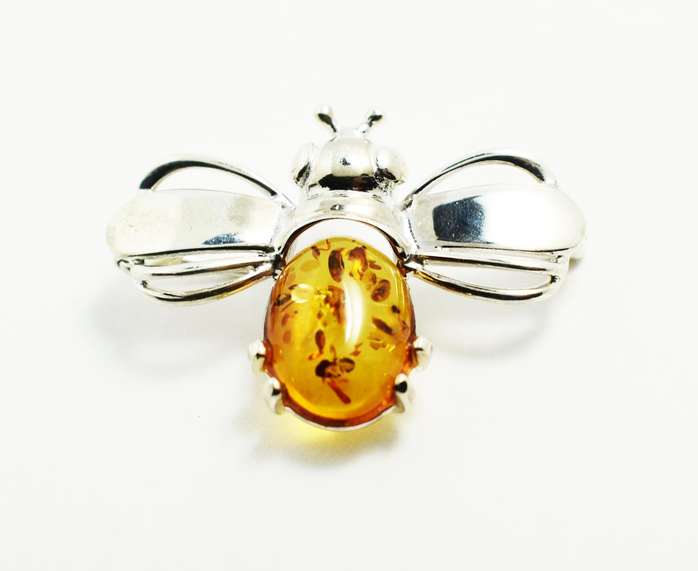 Baltic amber bee brooch set in sterling silver.