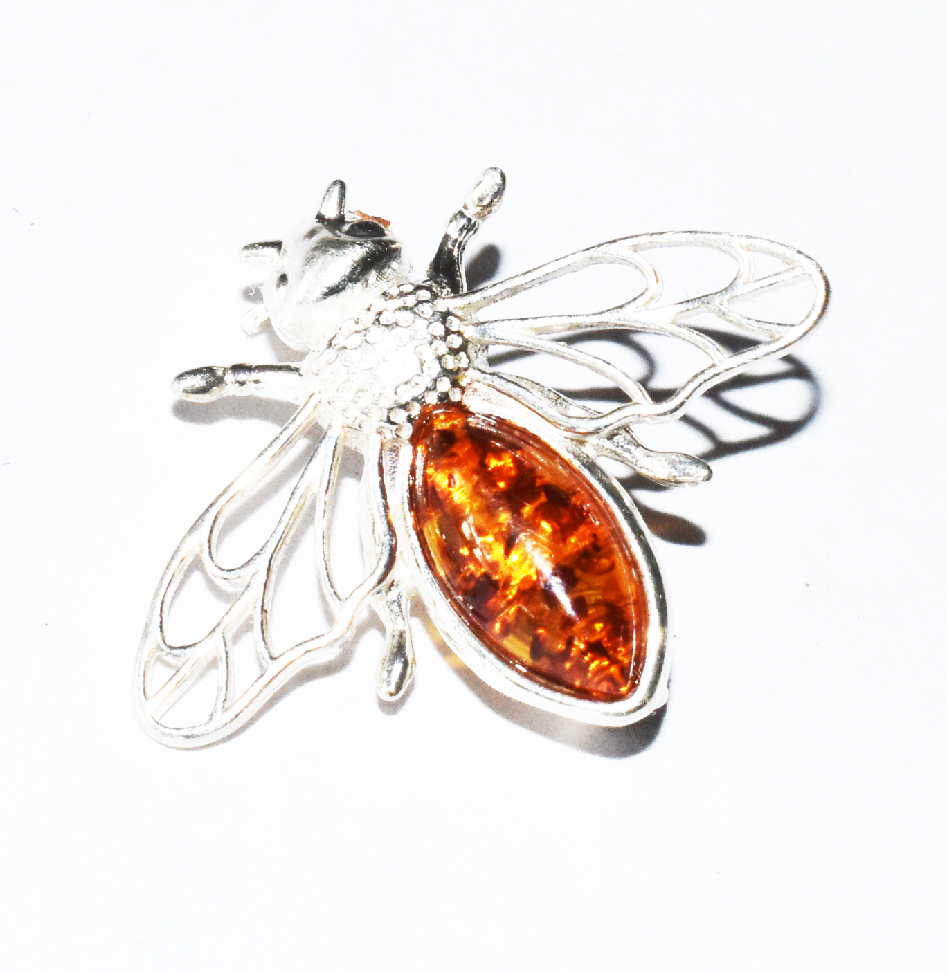 Filigree amber and silver bee brooch