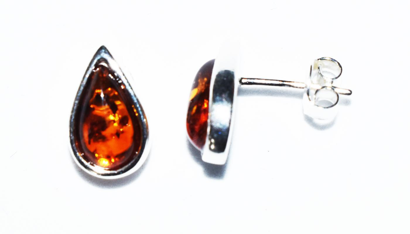Amber teardrop stud earrings set in sterling silver. 12x8mm