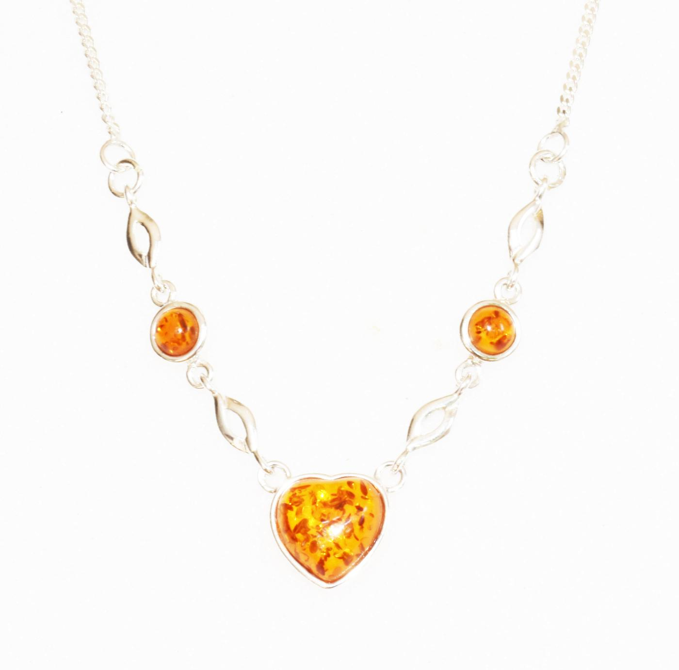 Baltic amber heart necklace set in sterling silver.