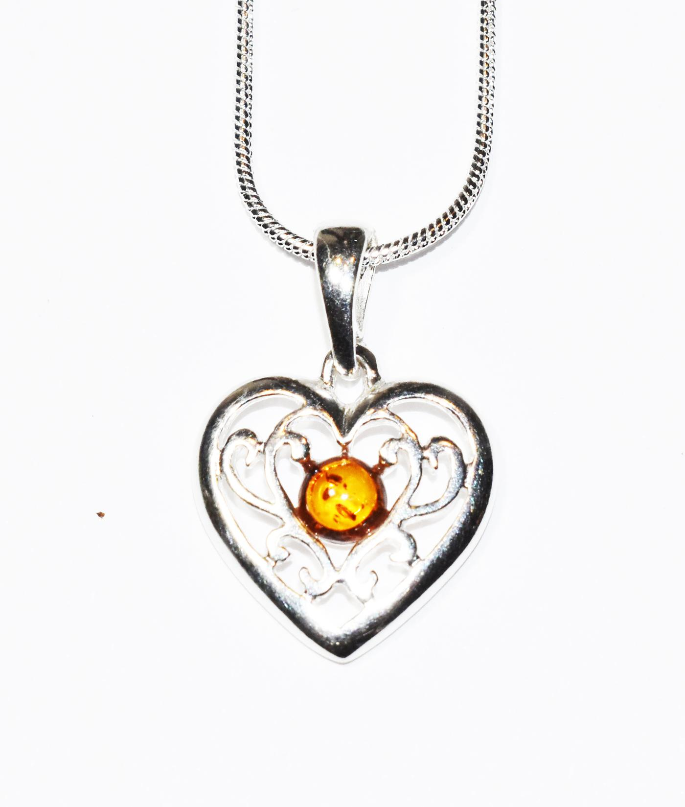 Amber gem set in shiny filigree  heart pendant. (P-06)