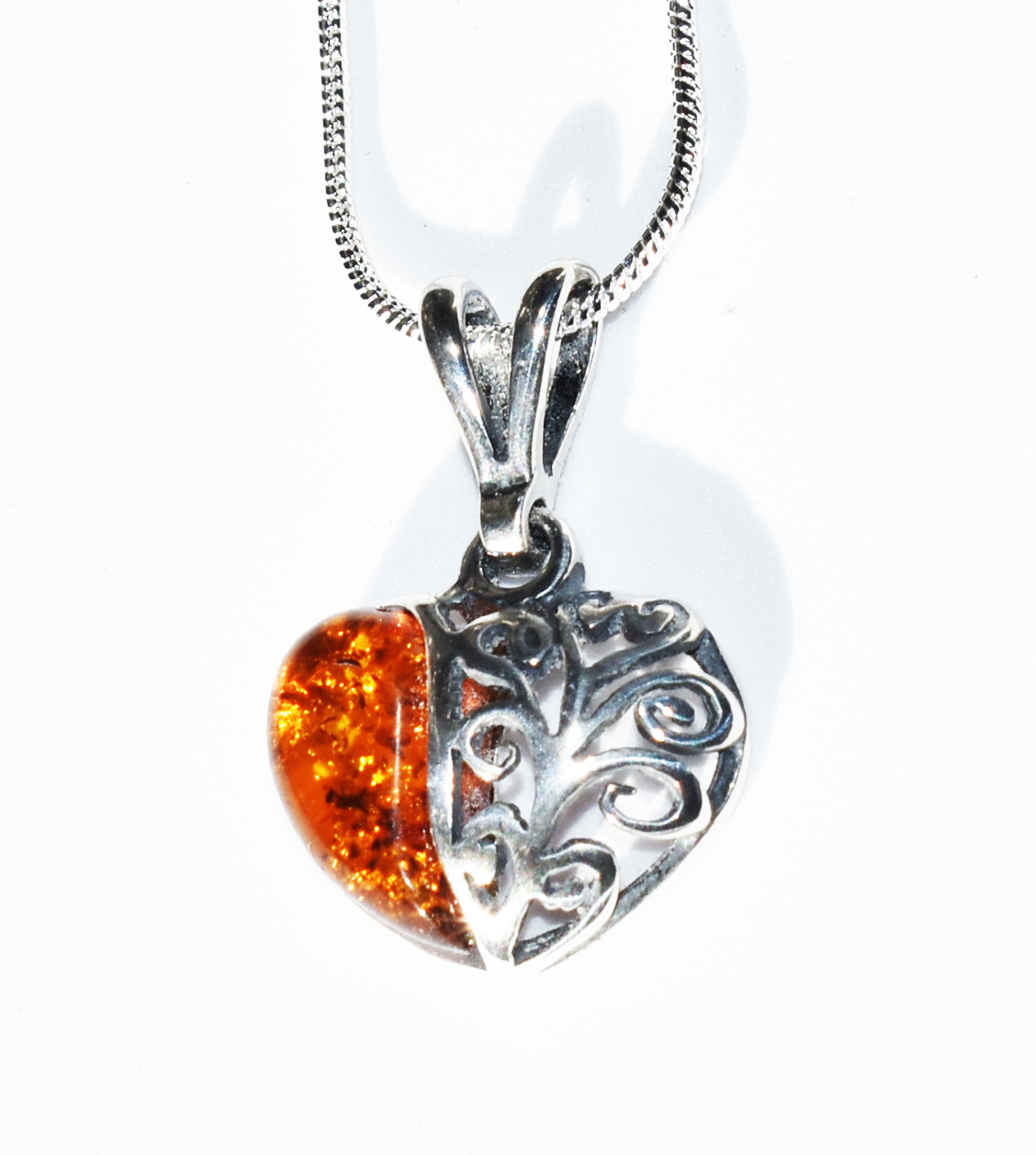 Baltic Amber Heart Pendant in lovely filigree setting on Sterling Silver Chain.