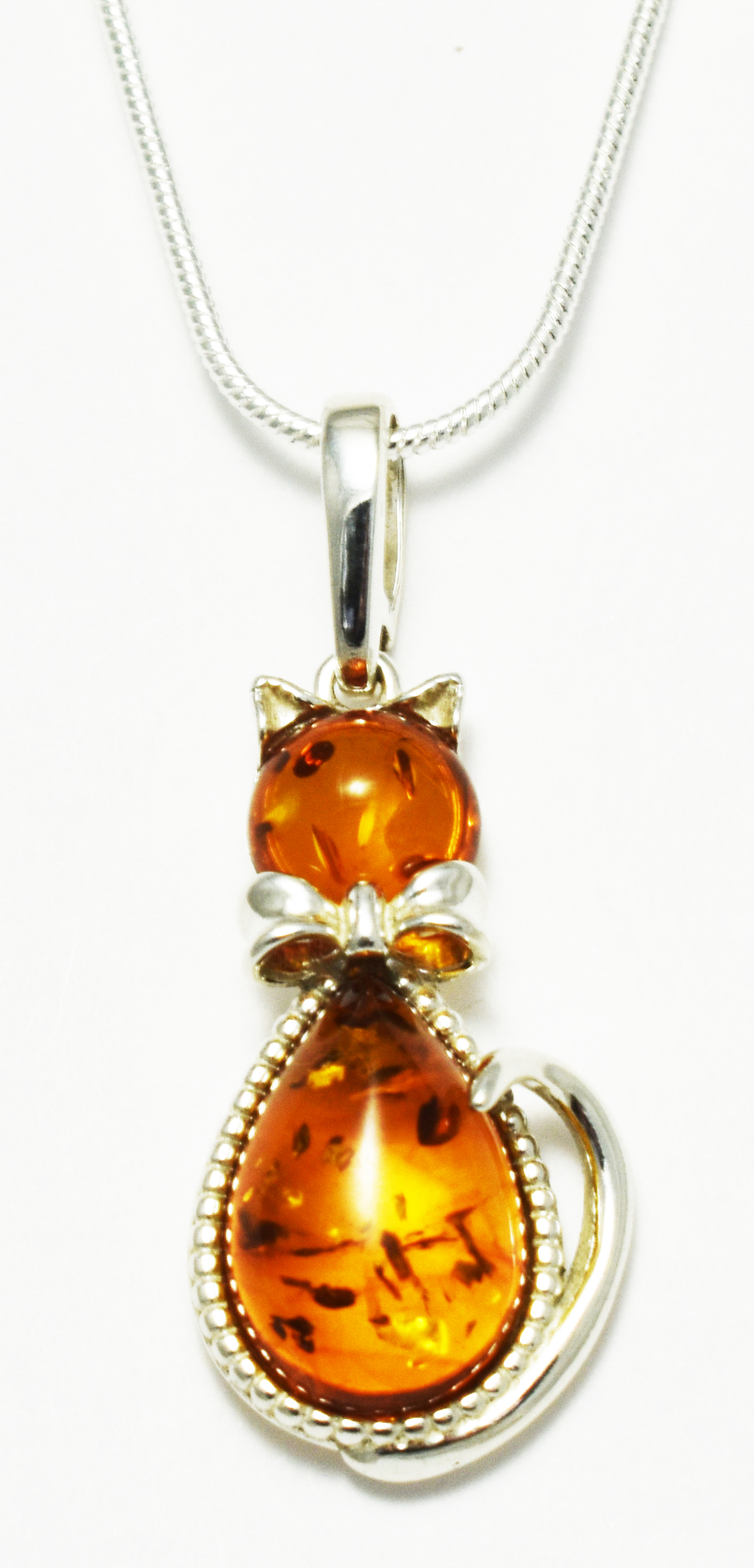 Gorgeous cat pendant hand made from Baltic Amber and silver.