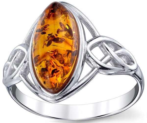 Cognac amber ring in Celtic stile silver work. stone size 14x7mm
