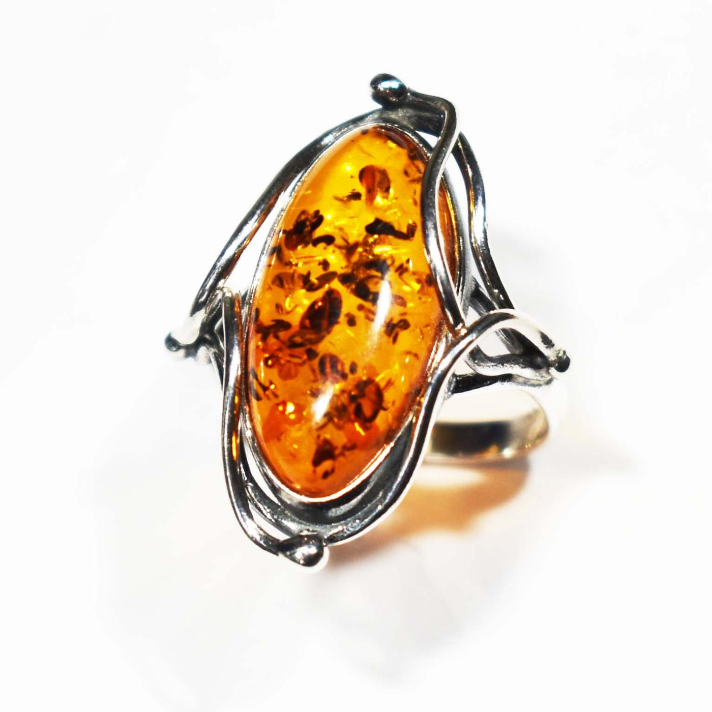 Stunning hand crafted ring in cognac   amber set in silver ring- 20x12mm